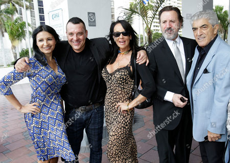 Kathrine Narducci, Frank Vincent, Frank Stallone, Melissa Prophet, Tom Sizemore A group of actors pose for photos before attending an event for Save America's Cinemas, a non-profit started to help save small-town theaters less than a year ago, in Miami Beach, Fla. From left, Kathrine Narducci, Tom Sizemore, Melissa Prophet, Frank Stallone and Frank Vincent. Owners of small cinemas across the country must switch from 35 mm film to digital - or go silent. The conversion requires new projection equipment, computers and a sound system that can average around $70,000 per screen
