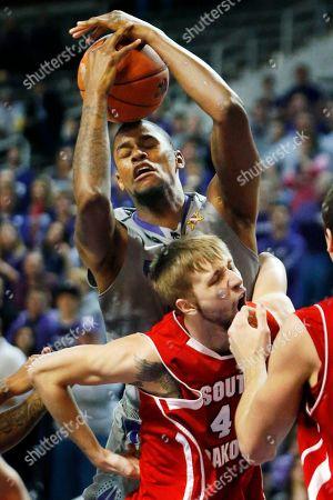 Jordan Henriquez, Eric Robertson Kansas State forward Jordan Henriquez (21) rebounds over South Dakota forward Eric Robertson (41) during the first half of an NCAA college basketball game in Manhattan, Kan