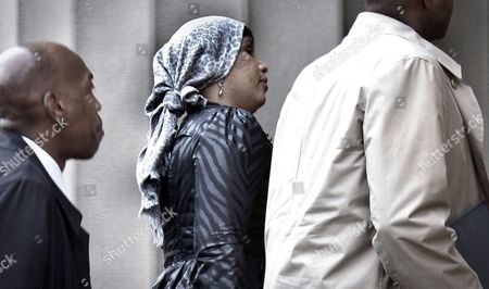 Nafissatou Diallo, who claims she was sexually assaulted by former International Monetary Fund leader Dominique Strauss-Kahn, arrives at a Bronx courthouse in New York. The outcome of the sexual assault lawsuit may soon be decided in court. Lawyers for both will update a judge Monday on the status of settlement discussions