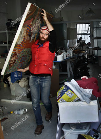 Stock Picture of John Gordon Gauld, an artist who lost paintings during superstorm Sandy, moves a painting out of his Red Hook studio on in New York