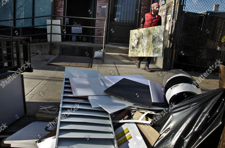 Stock Photo of John Gordon Gauld, an artist who lost paintings during superstorm Sandy, moves a painting out of his Red Hook studio on in New York