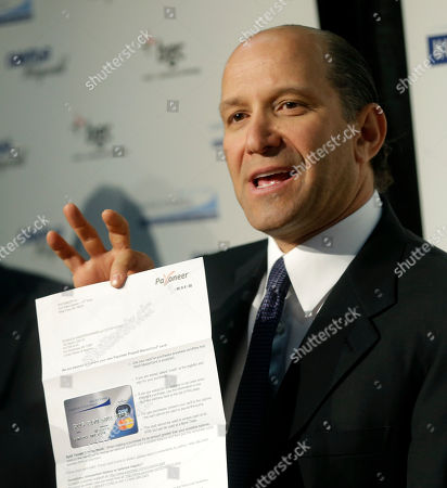 """Howard Lutnick Cantor Fitzgerald CEO Howard Lutnick displays a sample of the debit cards his company is distributing to Superstorm Sandy victims during a news conference in New York, . The New York City financial services firm that lost the most workers in the Sept. 11 terror attacks announced that it will """"adopt"""" 19 schools in communities hit hard by Superstorm Sandy and give a total of $10 million to families in those schools"""