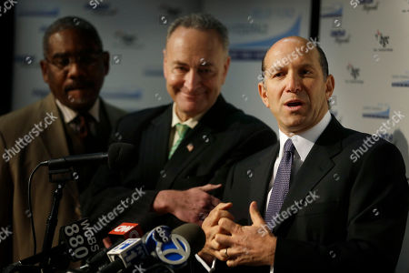 """Howard Lutnick, Charles Schumer, Gregory Meeks Cantor Fitzgerald CEO Howard Lutnick, right, speaks during a news conference while Sen. Charles Schumer, center, and Congressman Gregory Meeks listen at a school auditorium in the Rockaways section of New York, . The New York City financial services firm that lost the most workers in the Sept. 11 terror attacks announced that it will """"adopt"""" 19 schools in communities hit hard by Superstorm Sandy and give a total of $10 million to families in those schools"""