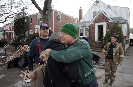 John Dwyer, Robert Tourres, Bill Spiers, Bruce Hurley New York firefighter John Dwyer, facing camera, hugs New Orleans firefighter Robert Tourres, after a group of New Orleans firemen assisted in the cleanup of the Dwyer family home, flooded in Superstorm Sandy, in the Belle Harbor section of Queens, N.Y., . The New Orleans Fire Department is returning the help given to Louisiana after Hurricane Katrina by firefighters and other emergency workers from New York. New Orleans firefighters Bill Spiers, left, and Bruce Hurley, Sr. joined in the cleanup
