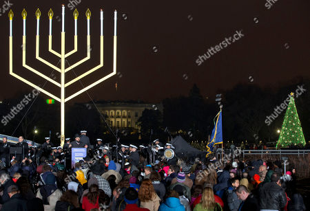 "With the White House in the background and the National Christmas Tree at right, people stand for a song at the end of the lighting of the National Hanukkah Menorah, during an event sponsored by the American Friends of Lubavitch, on The Ellipse in Washington marking the second night of the Jewish holiday Hanukkah. Starbucks' late 2015 cups, holiday drinks and merchandise put it in the legion of companies that have seized on the sales potential of the Christmas season, while preferring to glaze over religiosity in a country that is increasingly pluralistic, said Leigh Schmidt, author of ""Consumer Rites: The Buying and Selling of the American Holidays"