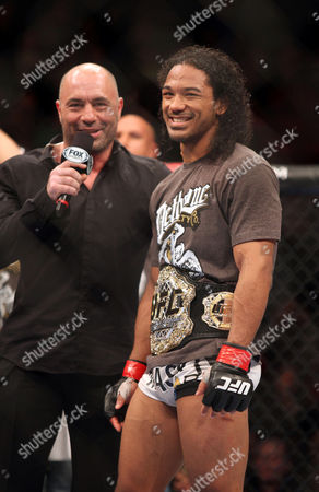 Benson Henderson, Joe Rogan UFC lightweight champion Benson Henderson is interviewed by FOX announcer Joe Rogan after his win against Nate Diaz in their mixed martial arts bout at a UFC on Fox event in Seattle, . Henderson retained his title via unanimous decision