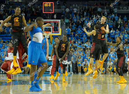 Byron Wesley, Dewayne Dedmon, Aaron Fuller, James Blasczyk, J.T. Terrell, Jordan Adams Members of the Southern California basketball team Byron Wesley, left, Dewayne Dedmon, third from left, Aaron Fuller, third from right, James Blasczyk, second from right, and J.T. Terrell celebrates as UCLA's Jordan Adams, second from left, looks on after their NCAA college basketball game, in Los Angeles. USC won 75-71