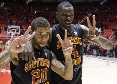 J.T. Terrell, Cedric Martin Southern California guard J.T. Terrell (20) and teammate Dewayne Dedmon (14) celebrate as they walk off the court at the end of their NCAA basketball game against Utah, in Salt Lake City. Southern California defeated Utah 76-59