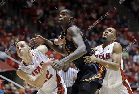 Jason Washburn, Justin Seymour, Dewayne Dedmon Utah center Jason Washburn, left, and teammate Utah guard Justin Seymour, right, battle for position with Southern California forward Dewayne Dedmon, center, in the second half during an NCAA college basketball game, in Salt Lake City. Southern California defeated Utah 76-59