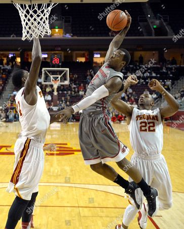 Mike Ladd, Dewayne Dedmon, Byron Wesley Washington State guard Mike Ladd, center, goes up for a dunk as Southern California forward Dewayne Dedmon, left, and guard Byron Wesley defend during the second half of their NCAA college basketball game, in Los Angeles. Southern California won the game 72-68