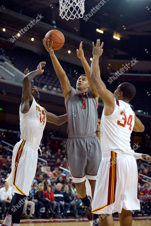 DaVonte Lacy, Dewayne Dedmon, Eric Wise Washington State guard DaVonte Lacy, center, puts up a shot as Southern California forward Dewayne Dedmon, left, and forward Eric Wise defend during the first half of their NCAA college basketball game, in Los Angeles