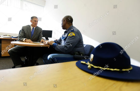 Jay Inslee, John Batiste In a meeting arranged for the benefit of news photographers, Gov.-elect Jay Inslee, left, chats with Washington State Patrol Chief John Batiste, right, in Inslee's transition office in Olympia, Wash. Inslee said Friday he was re-appointing Batiste despite objections from the Washington State Patrol Troopers Association, who had said that he was out of touch
