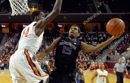 Scott Suggs, Dewayne Dedmon Washington guard Scott Suggs, right, puts up a shot as Southern California forward Dewayne Dedmon defends during the second half of their NCAA college basketball game, in Los Angeles. USC won 71-60