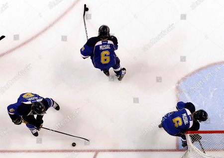 Members of the St. Louis Blues wear number 6 on their jerseys in honor of former St. Louis Cardinals baseball player Stan Musial as they warm up before the start of an NHL hockey game against the Minnesota Wild, in St. Louis. Musial, one of baseball's greatest hitters and a Hall of Famer with the Cardinals for more than two decades, died Saturday, Jan. 19 at the age of 92