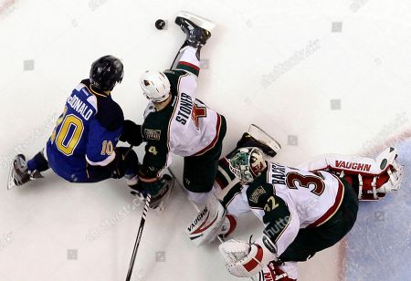 Niklas Backstrom, Andy McDonald, Clayton Stoner Minnesota Wild's Clayton Stoner, center, uses his foot to keep the puck away from St. Louis Blues' Andy McDonald, left, as Wild goalie Niklas Backstrom, of Finland, watches during the second period of an NHL hockey game, in St. Louis
