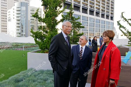Dave Bing, Ed Lee From left, Detroit Mayor Dave Bing, San Francisco Mayor Ed Lee and Bing's wife Yvette look over a rooftop garden and nearby construction during a visit to the headquarters of Twitter, in San Francisco. Bing made good on his World Series wager with Lee wherein the two vowed the leader of the losing team's city would tour economic ventures and perform some community service involving young people. The Giants swept the Tigers in four baseball games