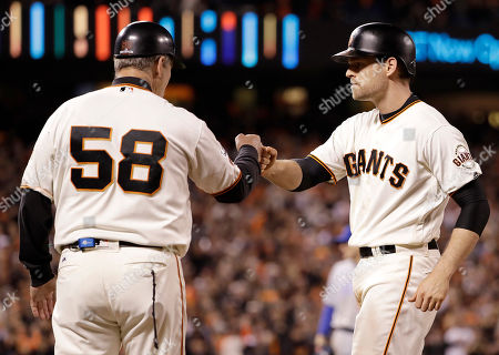 Conor Gillaspie, Bill Hayes San Francisco Giants' Conor Gillaspie, right, is congratulated by first base coach Bill Hayes (58) after hitting a run-scoring single against the Chicago Cubs during the fifth inning of Game 4 of baseball's National League Division Series in San Francisco