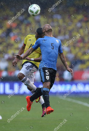 Colombia's Farid Diaz, left, fights for the ball with Uruguay's Carlos Sanchez during a 2018 World Cup qualifying soccer match in Barranquilla, Colombia