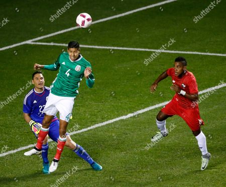 Moises Munoz, Hugo Ayala, Edgar Yoel Barcenas Mexico's Hugo Ayala (4) clears the ball away from goalkeeper Moises Munoz as Panama's Edgar Yoel Barcenas closes in during the first half of an exhibition soccer match, in Bridgeview, Ill