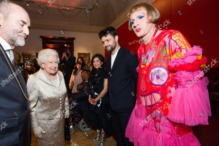 Queen Elizabeth II greets Farshid Moussavi, Conrad Shawcross and Grayson Perry as they attend a reception and awards ceremony at Royal Academy of Arts
