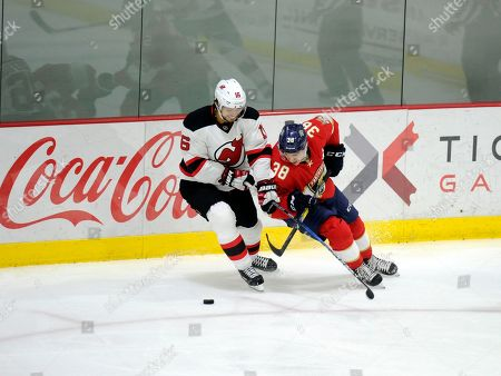 Andy Greene, Shane Harper Florida Panthers defenseman Andy Greene (6) and New Jersey Devils right wing Shane Harper (38) chase the puck during the first period of an NHL preseason hockey game, in West Point, N.Y. The Panthers won 4-2
