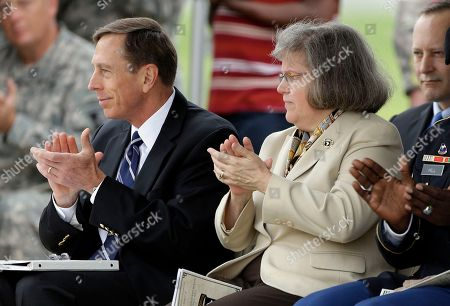 David Petraeus, Holly Petraeus This photo shows CIA Director David Petraeus, left, and his wife, Holly, during a ceremony at Fort Campbell, Ky