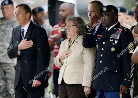 David Petraeus, Holly Petraeus This photo shows CIA Director David Petraeus, front left, and his wife, Holly, during a ceremony at Fort Campbell, Ky