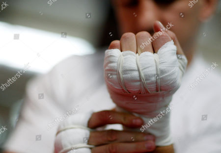 Tomasz Adamek Polish heavyweight boxer Tomasz Adamek looks at his taped hands as he prepares to workout at the World Boxing and Fitness Center in Jersey City, N.J., . Adamek will fight Travis Walker September 8, 2012, at Newark's Prudential Center