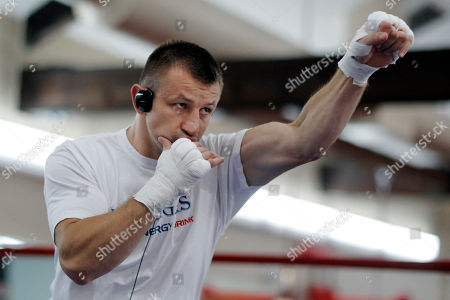 Tomasz Adamek Polish heavyweight boxer Tomasz Adamek wears headphones as he works out at the World Boxing and Fitness Center in Jersey City, N.J., . Adamek will fight Travis Walker September 8, 2012, at Newark's Prudential Center