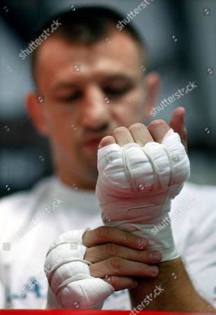 Tomasz Adamek Polish heavyweight boxer Tomasz Adamek looks at his taped hands as he prepares to work out at World Boxing and Fitness Center in Jersey City, N.J., . Adamek is scheduled fight Travis Walker on Sept. 8 in Newark, N.J