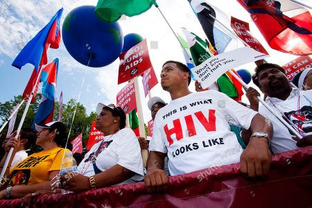 Stock Image of Marco Benjamin Marco Benjamin, 32, of New Brunswick, N.J., second from right, who is HIV positive, walks in the AIDS March in Washington