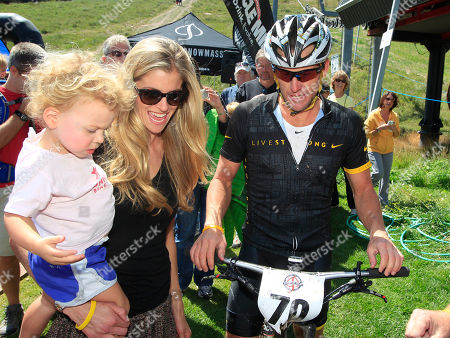 Lance Armstrong, Anna Hansen, Olivia Armstrong Lance Armstrong, right, jokes with his girlfriend, Anna Hansen, center, and their daughter, Olivia, after his second-place finish in the Power of Four mountain bicycle race at the base of Aspen Mountain in Aspen, Colo., on . The race is the first public appearance for Armstrong since the U.S. Anti-Doping Association stripped him of his seven Tour de France championships and banned him for life from professional cycling