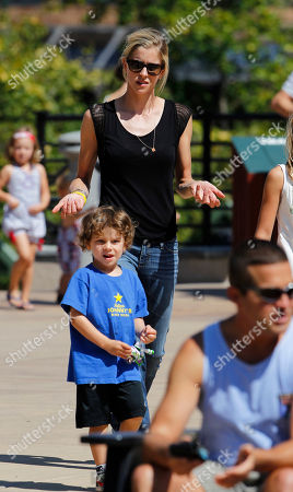 Anna Hansen Anna Hansen, back, girlfriend of Lance Armstrong, guides an unidentified young boy as she waits for Armstrong to finish in the Power of Four mountain bicycle race at the base of Aspen Mountain in Aspen, Colo., on . The race is the first public appearance for Armstrong since the U.S. Anti-Doping Association stripped him of his seven Tour de France championships and banned him for life from professional cycling