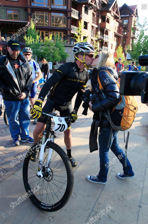 Stock Photo of Lance Armstrong, Anna Hansen Lance Armstrong kisses girlfriend Anna Hansen as Armstrong prepares to take part in the Power of Four mountain bicycle race at the starting line in Snowmass Village, Colo., early . The race is the first public appearance for Armstrong since the U.S. Anti-Doping Association stripped him of his seven Tour de France championships and banned him for life from the sport