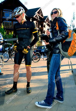 Stock Picture of Lance Armstrong, Anna Hansen Lance Armstrong, left, prepares to take part in the Power of Four mountain bicycle race, as his girlfriend Anna Hansen looks, in Snowmass Village, Colo. Authorities say the disgraced cyclist hit two parked cars after a night of partying in Aspen but agreed to let his girlfriend take the blame to avoid national attention. Police say they cited Armstrong after the Dec. 28, 2014, hit-and-run but only after his girlfriend, Anna Hansen, admitted to lying for him