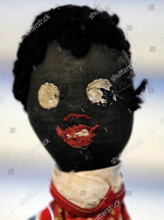 An historic black cloth doll appears on display in New Orleans. Amid rare antique dolls crafted in porcelain, whimsical Kewpies and homage to contemporary icon Barbie, cloth dolls in the image of African-Americans drew special attention as more than 1,200 collectors gathered in New Orleans for the annual convention of the United Federation of Doll Clubs