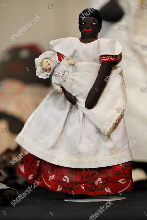 Historic black cloth dolls appear on display in New Orleans. Amid rare antique dolls crafted in porcelain, whimsical Kewpies and homage to contemporary icon Barbie, cloth dolls in the image of African-Americans drew special attention as more than 1,200 collectors gathered in New Orleans for the annual convention of the United Federation of Doll Clubs