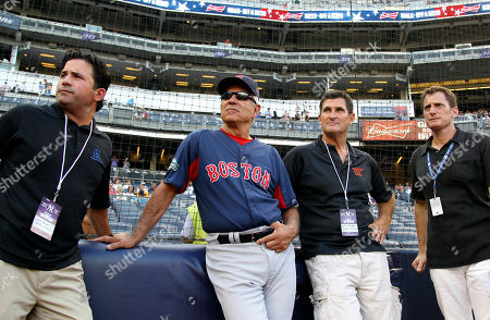 "Boston Red Sox manager Bobby Valentine, second from left, relaxes before the baseball game between the Red Sox and the New York Yankees at Yankee Stadium in New York. Valentine is an executive producer of a new documentary on Dominican baseball prospects, ""Ballplayer: Pelotero,"" a film that drew criticism from baseball Commissioner Bud Selig. And his production company has more pictures in the pipeline, including a flick about the NCAA and one on his famous father-in-law, Ralph Branca"