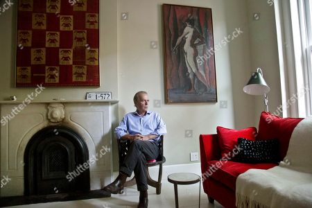 """This photo shows British novelist Martin Amis pose in the living room of his new home in the Brooklyn borough of New York. Amis's new novel is titled """"Lionel Asbo: State of England"""