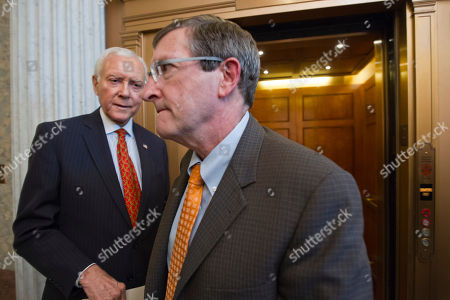 Kent Conrad, Orrin Hatch Sen. Orrin Hatch, R-Utah, left, and Sen. Kent Conrad, D-ND, right, both members of the tax-writing Senate Finance Committee, pass each other during final votes before the Senate leaves for a five-week recess, on Capitol Hill in Washington