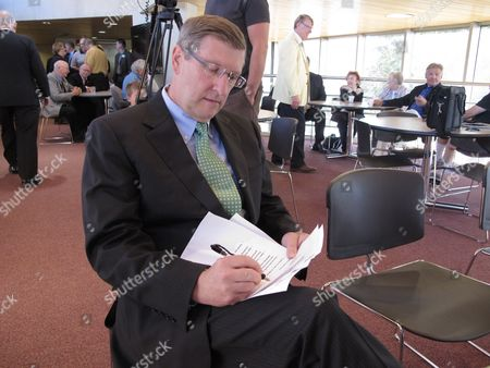 Stock Photo of North Dakota Sen. Kent Conrad makes notations on a copy of his remarks before a ceremony, at the North Dakota Heritage Center in Bismarck, N.D., at which Conrad donated his U.S. Senate papers to George Washington University in Washington, D.C. Conrad earned a master's degree in business administration at the school. The university and the State Historical Society of North Dakota are working on a cooperative arrangement to make the papers available to the public. They will be digitized and searchable on the Internet