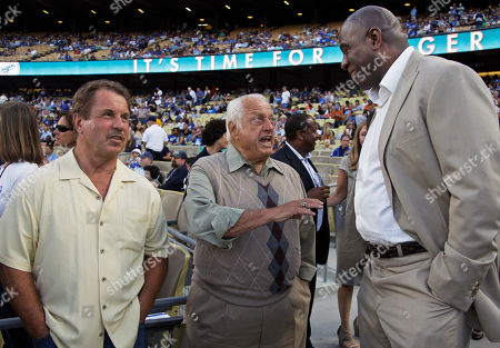 """Tommy Lasorda, Earvin """"Magic"""" Johnson, Ron Cey Former Los Angeles Dodger manager Tommy Lasorda, center, shares a moment with Dodgers co-owner Earvin """"Magic"""" Johnson, right, and former Dodger great Ron Cey at left before an Arizona Diamondbacks-Dodgers baseball game in Los Angeles"""