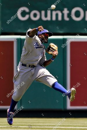 Tony Gwynn Los Angeles Dodgers center fielder Tony Gwynn throws to the infield after Los Angeles Angels' Kendrys Morales flied out during the first inning of an interleague baseball game in Anaheim, Calif
