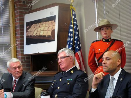 Mercer Armstrong, Michael Cotter, Kumar Kibble U.S. Attorney Michael Cotter, left, speaks with Royal Canadian Mounted Police Officer In Charge Mercer Armstrong, center, and Homeland Security Investigations Special Agent in Charge Kumar Kibble, right, before a news conference in Great Falls, Mont., on . Canadian and U.S. authorities gave details of a drug ring that smuggled more than 1,000 kilograms of cocaine and 1.3 million ecstasy pills across the border