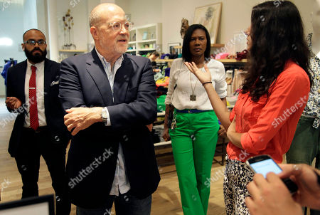 """Mickey Drexler This photo shows J. Crew CEO Millard """"Mickey"""" Drexler talking with employees at a J. Crew store in New York. Under his leadership, J. Crew has carved out a place in the fashion hierarchy that's just between trendsetter and accessible, and Drexler seems to like living in that space"""