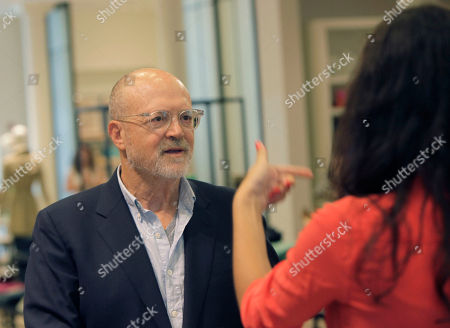 """Mickey Drexler This photo shows J. Crew CEO Millard """"Mickey"""" Drexler talking with an employee at a J. Crew store in New York. Under his leadership, J. Crew has carved out a place in the fashion hierarchy that's just between trendsetter and accessible, and Drexler seems to like living in that space"""