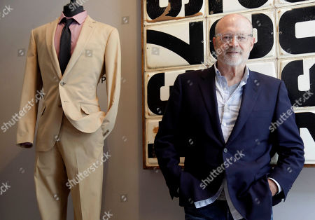 """Mickey Drexler This photo shows J. Crew CEO Millard """"Mickey"""" Drexler posing for a picture at a J. Crew store in New York. Under his leadership, J. Crew has carved out a place in the fashion hierarchy that's just between trendsetter and accessible, and Drexler seems to like living in that space"""