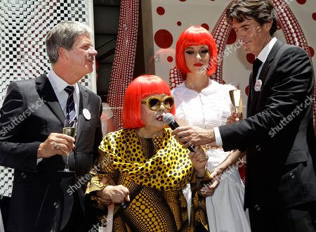 Stock Picture of Yayoi Kusama, Yves Carcelle, Jordi Konstans A model poses beside Japanese artist Yayoi Kusama, center, Louis Vuitton CEO Yves Carcelle, far left, and Vuitton second-in-command Jordi Konstans in front of the windows Kusama helped design at Vuitton's flagship Fifth Avenue store for the unveiling of a new collaborative collection by Kusama and Vuitton creative director Marc Jacobs in New York