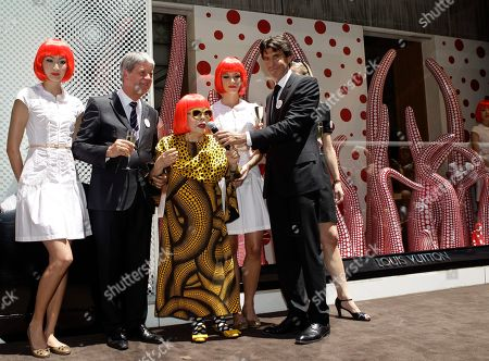 Stock Image of Yayoi Kusama, Yves Carcelle, Jordi Konstans Models pose beside Japanese artist Yayoi Kusama, center, Louis Vuitton CEO Yves Carcelle, second from left, and Vuitton second-in-command Jordi Konstans in front of the windows Kusama helped design at Vuitton's flagship Fifth Avenue store for the unveiling of a new collaborative collection by Kusama and Vuitton creative director Marc Jacobs in New York