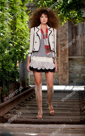 A model wearing a design from the Skaist Taylor Spring 2013 collection during Fashion Week in New York. Designers Pamela Skaist-Levy and Gela Nash Taylor say they are committed to creating clothes for their closets like rompers, eyelet skirts and boucle jackets, in a season when many other designers are toning it down
